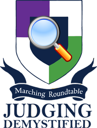 Marching Roundtable Judges Academy Judging Demystified Shield Logo